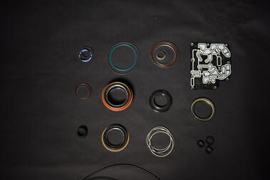 Aftermarket transmission seal kit laid out on a workbench