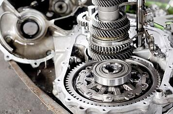Disassembled automatic transmission with multiple speeds on a workbench