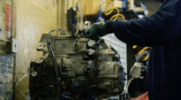 Transmission technicians rebuilding a unit using quality overhaul kit components
