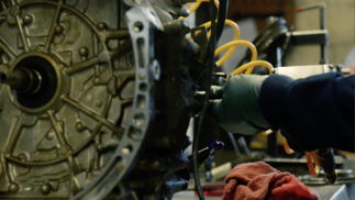 Transmission technician performing a rebuild using a transmission overhaul kit